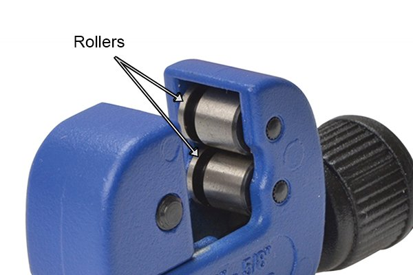 Part of an adjustable pipe cutter; rollers