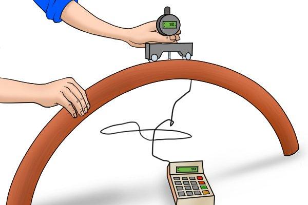 Using a digital radius gauge to measure bent pipe