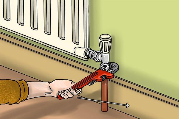 Undoing lower radiator valve nut