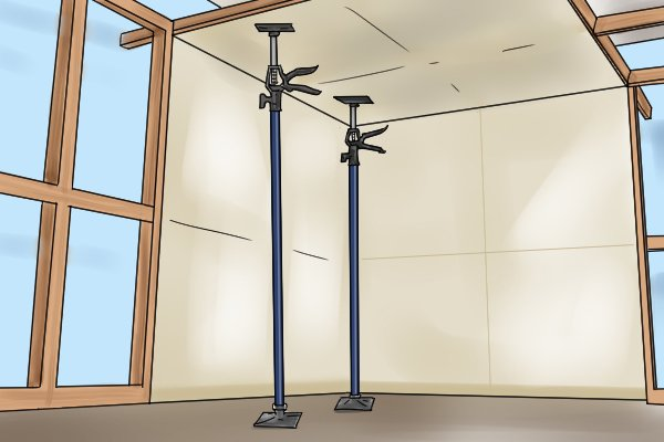 2 adjustable support props supporting drywall ceiling panel