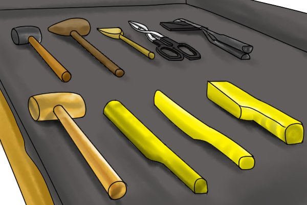 Examples of lead workers' tools including seaming pliers