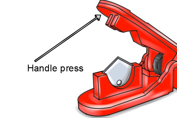 Parts of a pivot joint tube cutter; handle press
