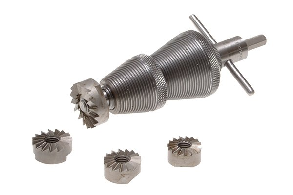 tap reseater with spare cutters and tapered cones