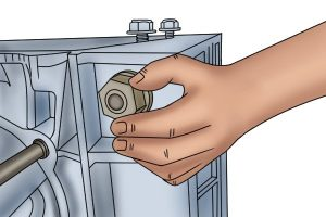Place the nut on the end of the bolt.