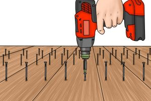 Illustration of impact driver in use with wood.