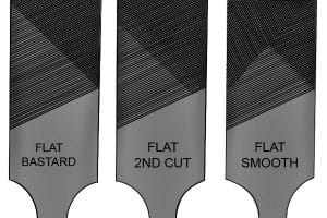 Flat bastard file, flat 2nd cut file and flat smooth file used to sharpen a blade