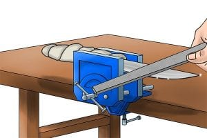 Step 3: Using a shallow angle apply the file against the blade