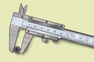 Vernier caliper measuring a socket set