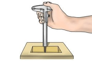 Example of how to use a vernier caliper to measure depth.