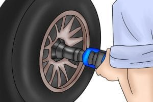 Impact socket in use removing nuts from a tyre