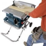 Bosch 10-Inch Worksite Table Saw 4100-09 in use cutting materials
