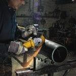 DEWALT Angle Grinder Tool DWE401 cutting metal