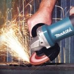 Makita 9557PBX1 Angle Grinder in use