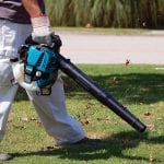 Makita BHX2500CA Commercial Grade 4Stroke 24.5cc Handheld Blower in use