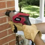 Hammer Drill drilling through a brick hall
