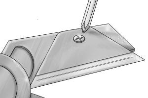 Fastening in a new mitre shear blade