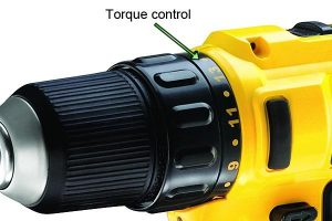 Adjusting torque control on drills.