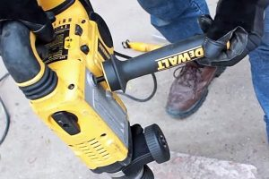 SDS max drill side handle can be fitted to front or rear.
