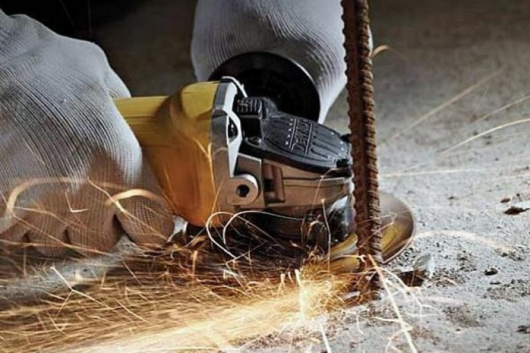 Cutting metal with an angle grinder.
