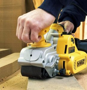 Dewalt belt sander in use.