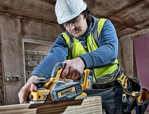 Dewalt cordless planer in use.