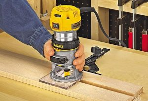 Dewalt router in use on wood.