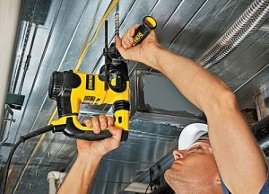 Drilling into metal ceiling with SDS plus drill.