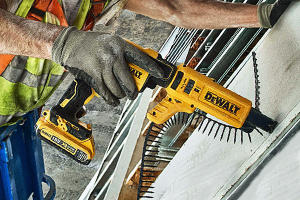 Drywall screwdriver being used with collated screw magazine.