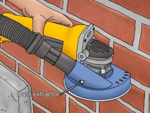 Detailed diagram of a dust extractor attached to a mortar rake.