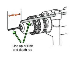 Percussion drill depth rod adjustment.