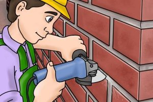 Removing brick mortar with an angel grinder.