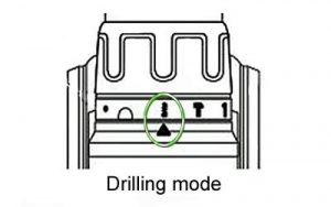Setting hammer drill setting to drilling mode.