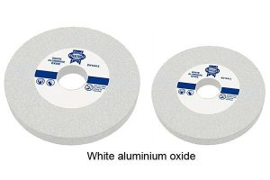 Two white grounding wheels manufactured with white aluminum oxide.
