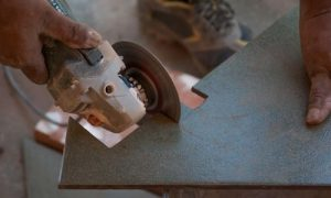 Example of how to cut wall and floor tiles using an angle grinder.
